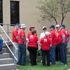 BBQ volunteers huddle before a serving line shift.
