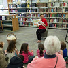 National Cherry Queen Sonya Sayler reads the children's book Woolbur by Leslie Helakoski.
