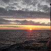 Maritime cadets sail towards the rising sun on board the T/S State Of Michigan.