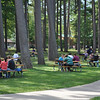 Students enjoy a break from class outside underneath the pines